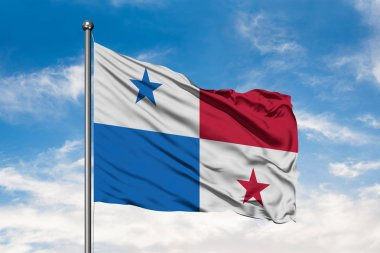 Flag of Panama waving in the wind against white cloudy blue sky. Panamanian flag.