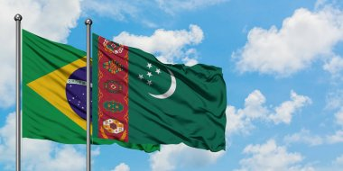 Brazil and Turkmenistan flag waving in the wind against white cloudy blue sky together. Diplomacy concept, international relations.