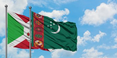 Burundi and Turkmenistan flag waving in the wind against white cloudy blue sky together. Diplomacy concept, international relations.
