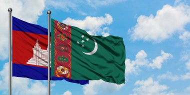 Cambodia and Turkmenistan flag waving in the wind against white cloudy blue sky together. Diplomacy concept, international relations.