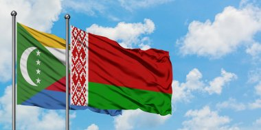 Comoros and Belarus flag waving in the wind against white cloudy blue sky together. Diplomacy concept, international relations.