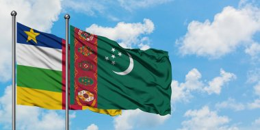 Central African Republic and Turkmenistan flag waving in the wind against white cloudy blue sky together. Diplomacy concept, international relations.