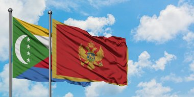 Comoros and Montenegro flag waving in the wind against white cloudy blue sky together. Diplomacy concept, international relations.