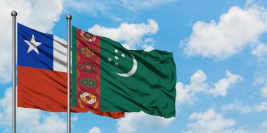 Chile and Turkmenistan flag waving in the wind against white cloudy blue sky together. Diplomacy concept, international relations.