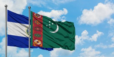 El Salvador and Turkmenistan flag waving in the wind against white cloudy blue sky together. Diplomacy concept, international relations.