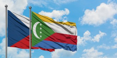 Czech Republic and Comoros flag waving in the wind against white cloudy blue sky together. Diplomacy concept, international relations.