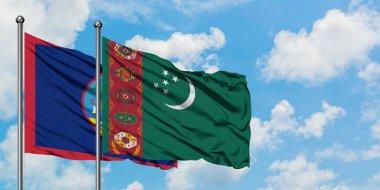 """Картина, постер, плакат, фотообои """"Флаг Гуама и Туркменистана развевается на ветру на фоне бело-облачного голубого неба вместе. Концепция дипломатии, международные отношения."""", артикул 264983952"""
