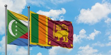 Comoros and Sri Lanka flag waving in the wind against white cloudy blue sky together. Diplomacy concept, international relations.