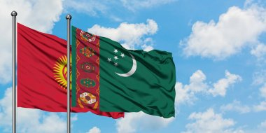 Kyrgyzstan and Turkmenistan flag waving in the wind against white cloudy blue sky together. Diplomacy concept, international relations.