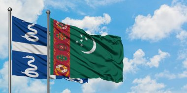 Martinique and Turkmenistan flag waving in the wind against white cloudy blue sky together. Diplomacy concept, international relations.