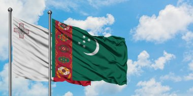 Malta and Turkmenistan flag waving in the wind against white cloudy blue sky together. Diplomacy concept, international relations.