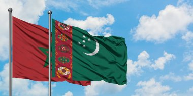 Morocco and Turkmenistan flag waving in the wind against white cloudy blue sky together. Diplomacy concept, international relations.