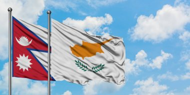 Nepal and Cyprus flag waving in the wind against white cloudy blue sky together. Diplomacy concept, international relations.