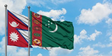 Nepal and Turkmenistan flag waving in the wind against white cloudy blue sky together. Diplomacy concept, international relations.