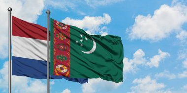 Netherlands and Turkmenistan flag waving in the wind against white cloudy blue sky together. Diplomacy concept, international relations.