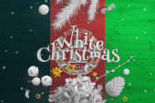Fotografie Afghanistan flag on wooden table with White Christmas text. Christmas and new year background, celebration national concept with white decor.