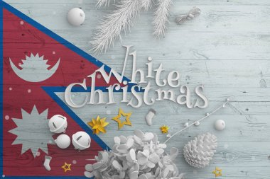 Nepal flag on wooden table with White Christmas text. Christmas and new year background, celebration national concept with white decor.