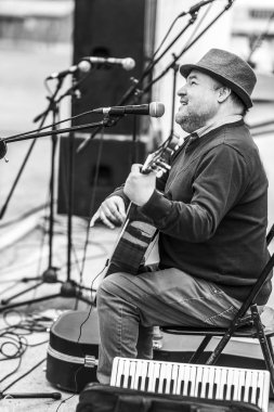 City: El Volcan, Santiago Country: Chile 8th October 2019 Miners Day celebration at El Volcan village inside Cajon del Maipo valley at the Andes. Blind musician playing spanish guitar during the party