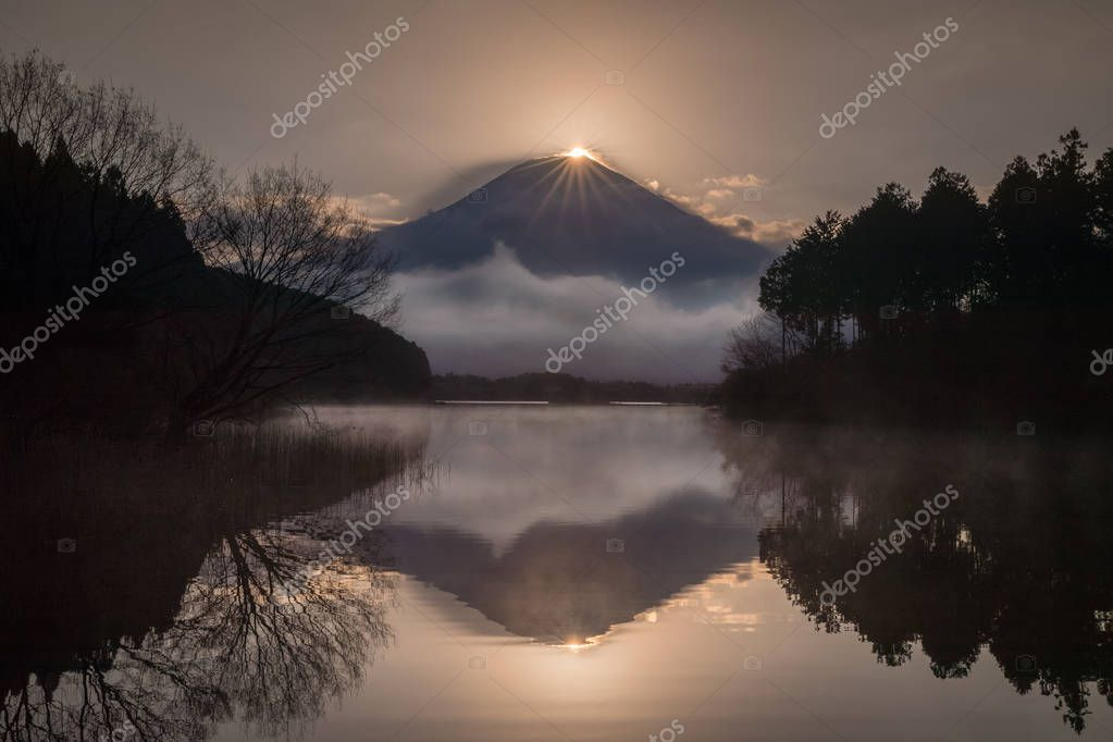 Diamond Fuji at Tanuki lake in morning spring season. Diamond Fuji is the name given to the view of the setting sun meeting the summit of Mt. Fuji.