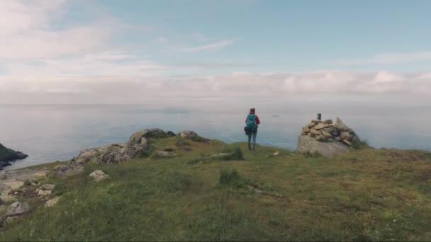 girl hiker near ocean