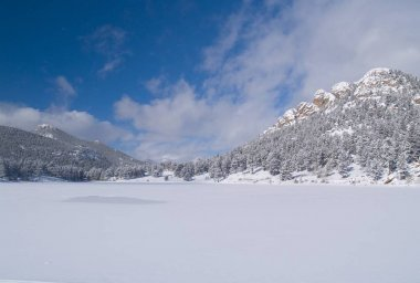 Copeland Lake in winter with a fast moving sky.
