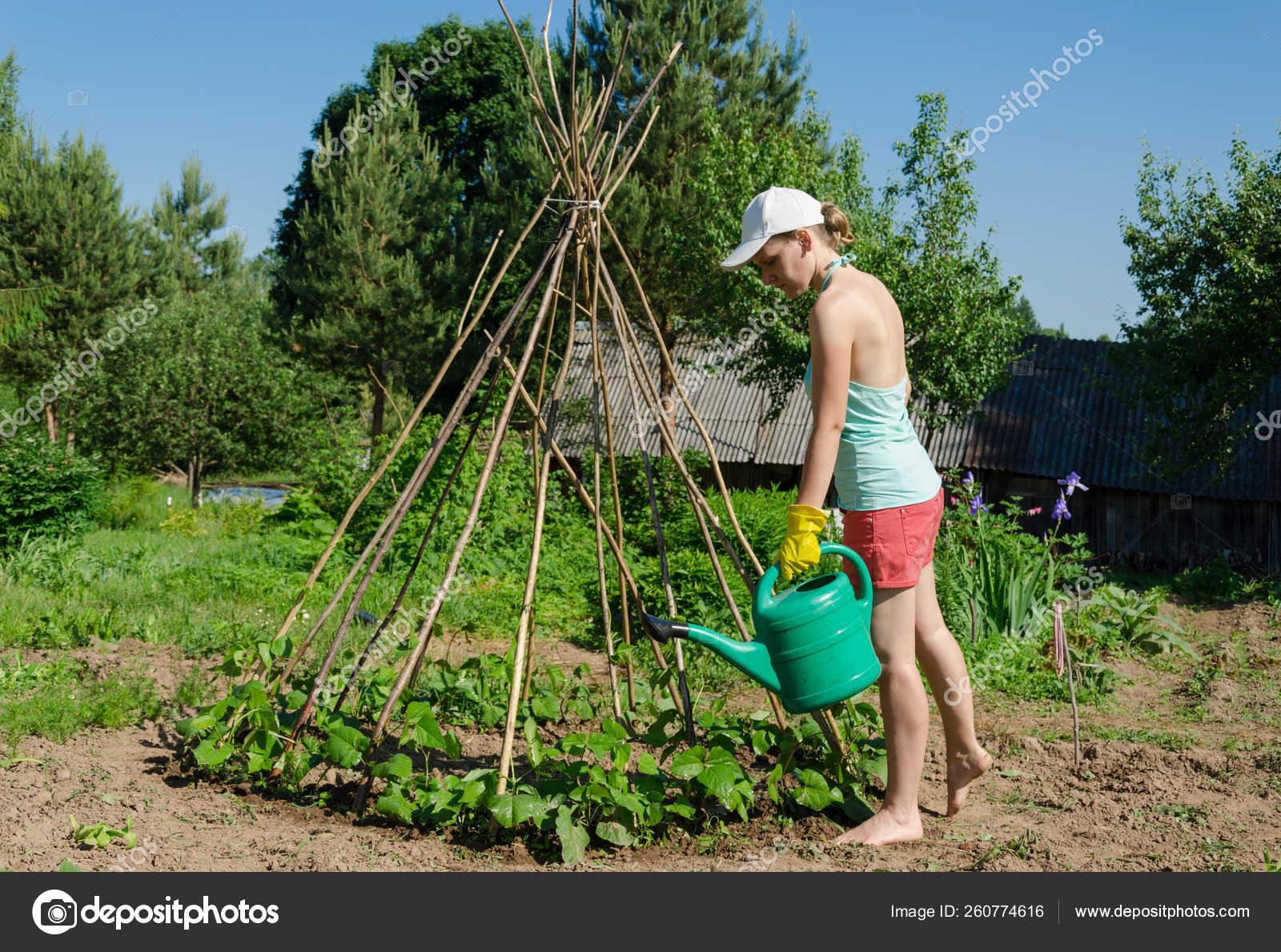 https://st4.depositphotos.com/20524830/26077/i/1600/depositphotos_260774616-stock-photo-girl-garden-watering-can-goes.jpg