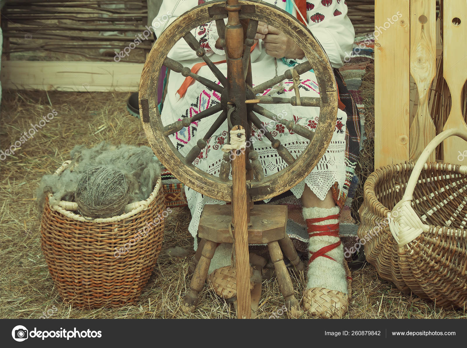 Old Spinning Wheel Sits Elderly Woman National Costume Worked Spinning Stock Photo C Yayimages 260879842