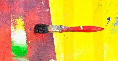 Paintbrush on colorful background