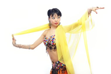 Asian lady dancing belly-dance with yellow fabric