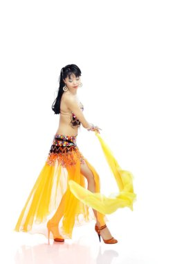 Dancer in the orange costume playing with yellow cloth