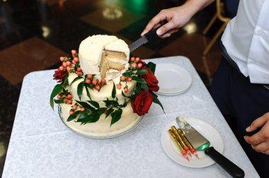 wedding cake with a cut piece