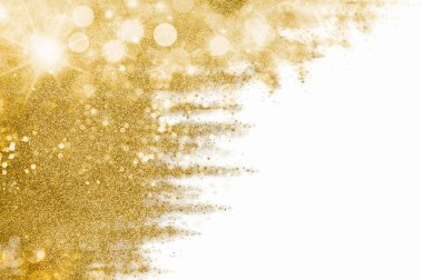 Golden Christmas background with sparkling and twinkling bokeh, gold glitter over white with copyspace for your seasonal greetings. Festive abstract gilt background.