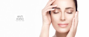 Anti aging treatment and plastic surgery concept. Beautiful serene woman with fresh clean skin. Heathy skin woman gracefully holding hands to her face. Cosmetology, beauty treatment and skincare.