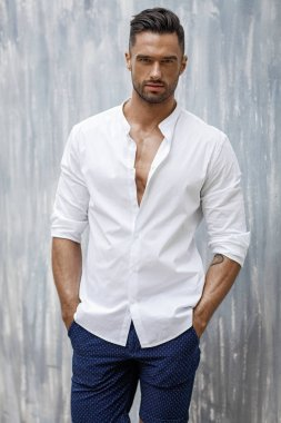 Portrait of handsome man in white shirt