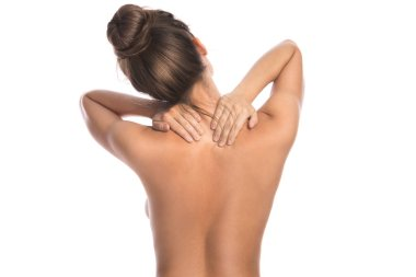 Woman with pain in back and neck on white background