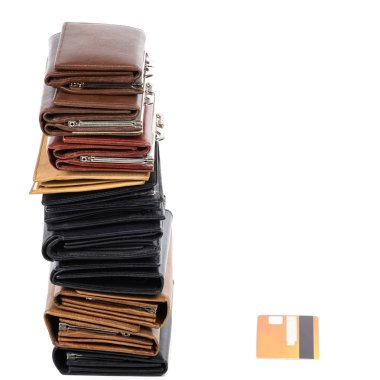 A pile of leather wallets and one credit card