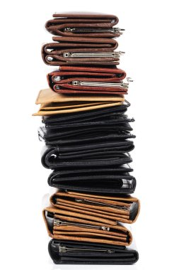 Close up view of different leather wallets isolated on white background