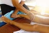 Fotografie Close up view of female foot during traditional Thai massage