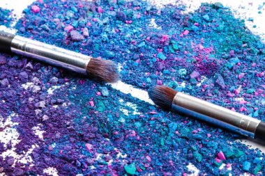 Close up of crushed eyeshadows and make-up brushes stock vector