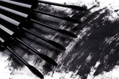 Close up view of brushes and smudged mascara