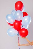 Fotografie Many colorful balloons isolated on gray background