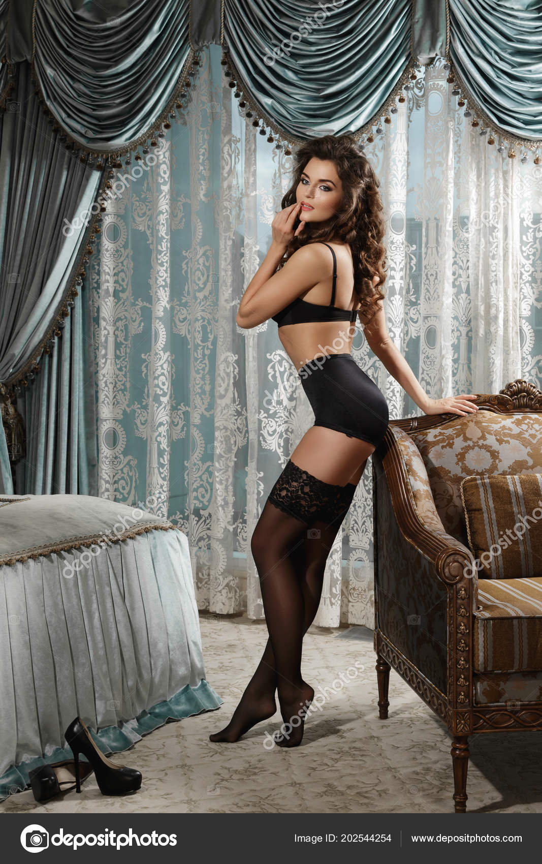 0f1d0d389 Sexy Woman Wearing Beautiful Lingerie Black Stockings Posing Bedroom —  Stock Photo