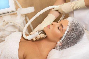 Woman in professional beauty salon during contour plastic procedure