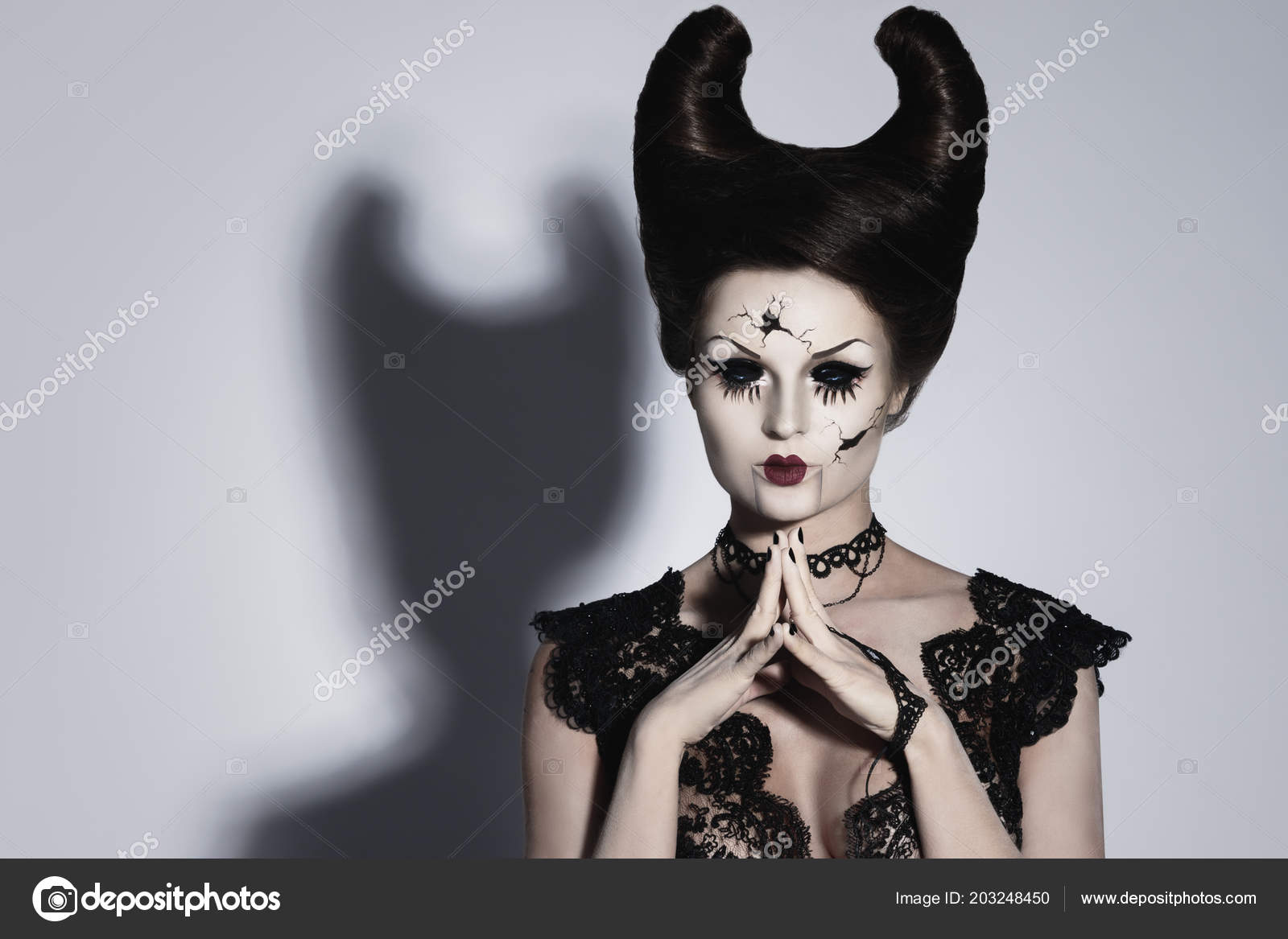 model creative image halloween spooky porcelain doll horns her head stock photo