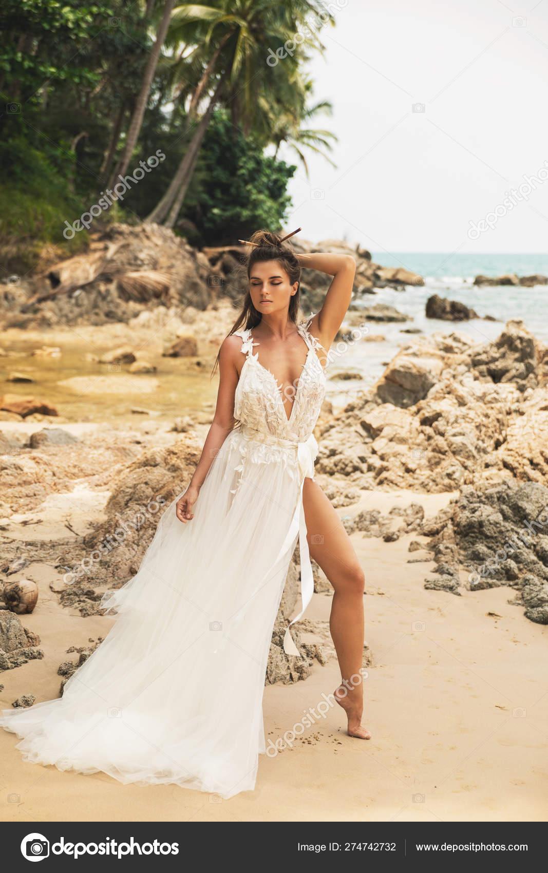 Bride Wearing Beautiful Wedding Dress On The Tropical Beach Stock