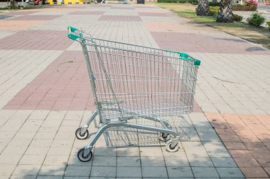 supermarket trolleyblurred background with empty red shopping cart