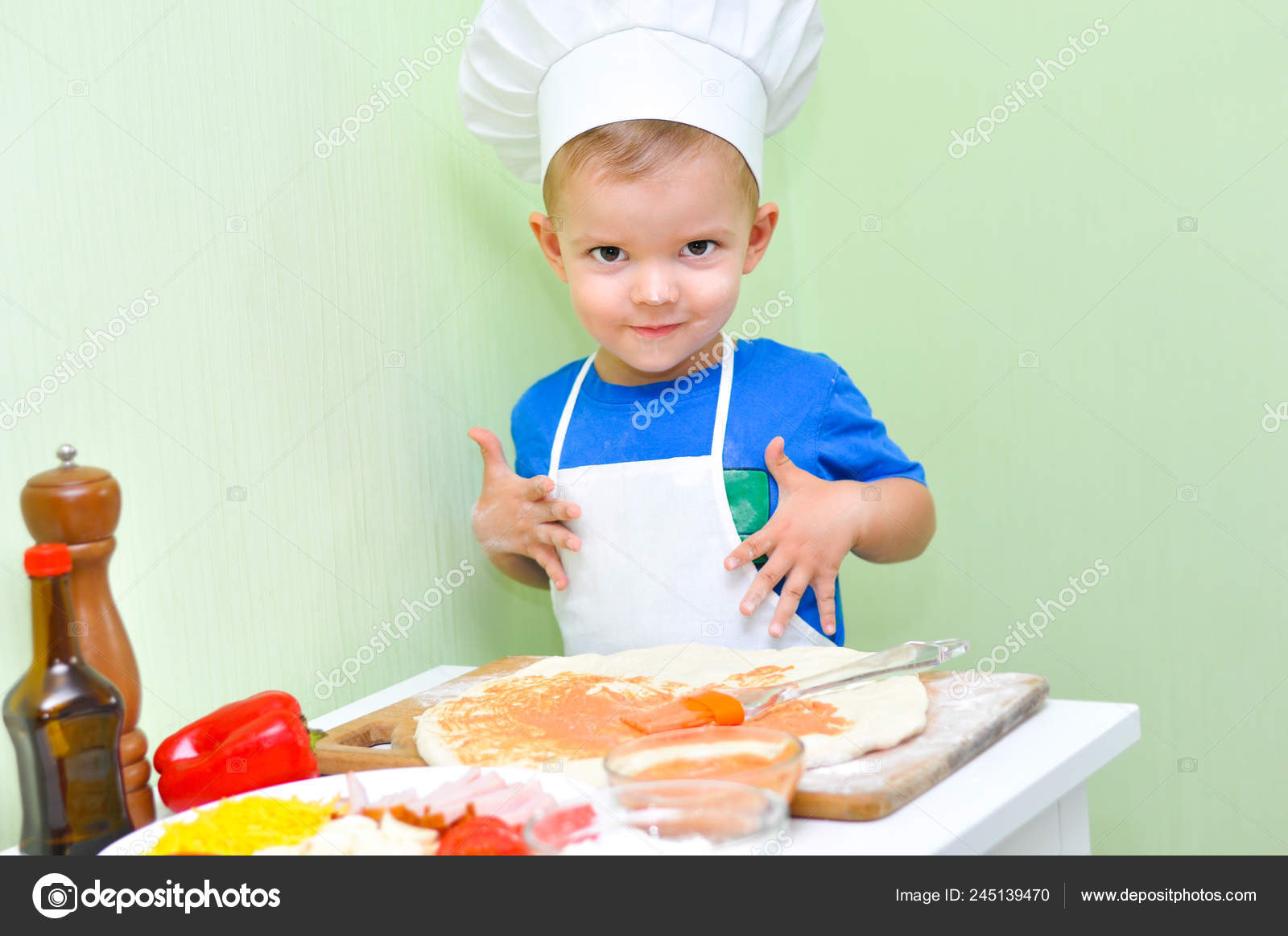 Little Smiling Kid Boy Cooking Pizza White Chef Hat Apron Stock