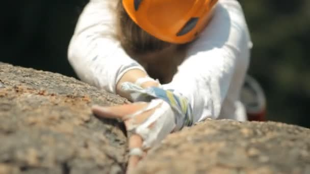 Young female climber makes the ascent.