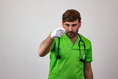 Portrait of male veterinary doctor in green uniform with brown h