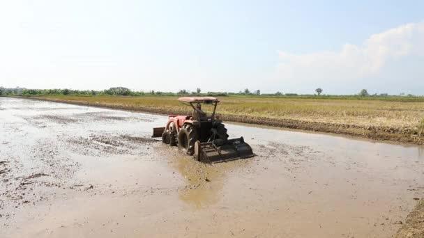Tractor on harvest field, rural scene